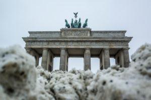 Brandenburg Gate behind snow pile, Mitte, Berlin