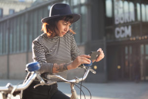Young woman by bicycle in Barcelona, Catalonia, Spain