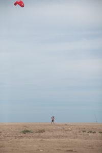 Spain, Ebro Delta, beach, man with sport kite