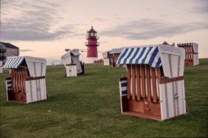 Beach chairs, lighthouse, North Sea