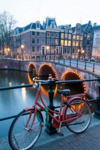 Bicycle at the handrail, dusk, 'Leidsegracht', corner 'Keizersgracht', Amsterdam, Holland, Netherlands