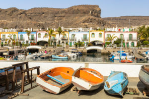 Old boats at the port of Puerto de Mogan overlooking promenade, southwest Gran Canaria, Spain