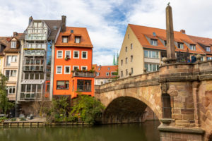 View of Charles Bridge and houses on the Pegnitz River in the afternoon, Nuremberg city center, Franconia, Bavaria, Germany