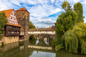 View from Maxbrücke to the Pegnitz (river) and the Henkerbrücke with water tower in the afternoon, Nuremberg city center, Franconia, Bavaria, Germany
