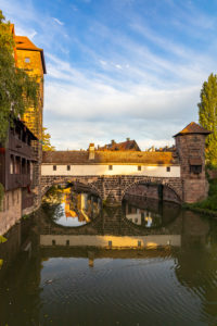 View from Maxbrücke to the Pegnitz (river) and the Henker's Bridge in the evening light, Nuremberg city center, Franconia, Bavaria, Germany