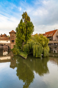 View from Maxbrücke to the Pegnitz (river) and the Henkerbrücke + Henkersteg in the afternoon, Nuremberg city center, Franconia, Bavaria, Germany