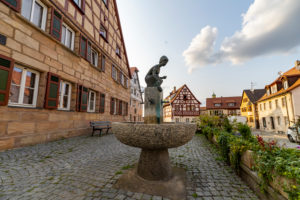 Brestlas fountain on the market square of Cadolzburg, Franconia, Bavaria, Germany