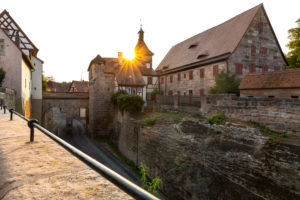 Sunset over entrance to Cadolzburg Castle on Burggraben, Cadolzburg, Franconia, Bavaria, Germany