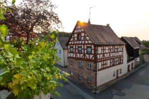 View from the entrance to Cadolzburg Castle on the vine and half-timbered house, Cadolzburg, Franconia, Bavaria, Germany