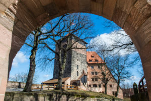 Look through a gate to the imperial castle of Nuremberg, Bavaria, Germany