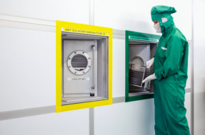Duisburg, North Rhine-Westphalia, Germany - high technology in the Ruhr area. A microtechnologist works in the clean room at the Fraunhofer Institute for Microelectronic Circuits and Systems. As an operator, she monitors the sputtering process.