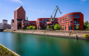 Inner harbor Duisburg with the wave-shaped new building of the North Rhine-Westphalia State Archive, the converted archive tower in the former RWSG storage building and old harbor cranes, Duisburg, Ruhr area, North Rhine-Westphalia, Germany