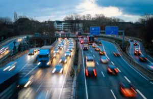 Rush hour traffic on the A40 motorway in Essen, blue environmental zone, this area would be affected by a diesel driving ban, Essen, Ruhr area, North Rhine-Westphalia, Germany