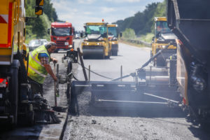 Road construction, asphalt pavers and road rollers paving whispered asphalt, rehabilitation of the A3 motorway between the crosses Kaiserberg and Breitscheid, Duisburg, North Rhine-Westphalia, Germany