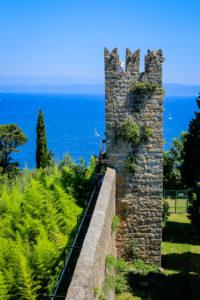 Piran, Istria, Slovenia - Tourists visit the historic city walls of the Mediterranean port city.