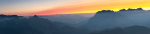 Sunrise over the Karwendel Mountains with a view of the western Karwendelspitze and the Hochkarspitze in Austria.