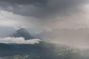 Storm in the Karwendel Mountains with a view of Seefeld and the Hohe Munde (2662 m) in Austria.