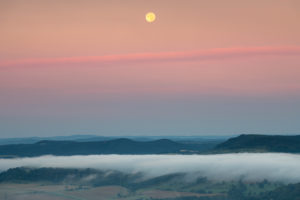 Moonset in the Saale valley in Thuringia during the sunrise.