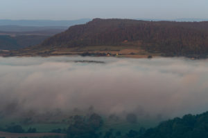 Sunrise with fog in the Saale valley, view from the Leuchtenburg in Thuringia.