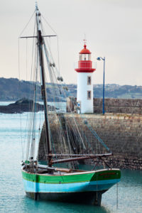 Morning mood at the lighthouse of Eruqy - harbor entrance with boats. Brittany France