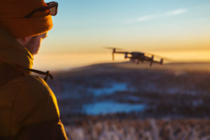 Photographer with Drone in winter