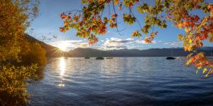 Sunrise on lake Walchen, boats, maple, autumn, foliage