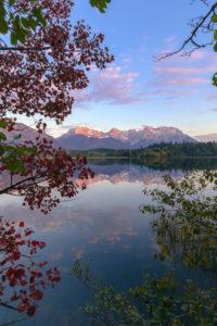 Sunset glow at Lake Barmsee, autumn, Karwendel Mountain Range, reflection, clouds