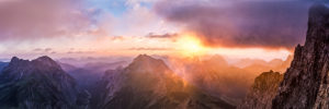Sunrise on the Laliderer Wand, on the right is a gloomy cloud over the Dreizinkenspitze, on the left is the Laliderer Valley, mountains: on the left the Falken group, in the middle the Gamsspitze and on the far right the Dreizinkenspitze