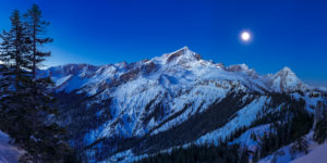 View of the Alpspitze and the Zugspitze from the Kreuzjoch by moonlight, on the left side the Stuiben, on the right the Hochalm and on the right the Kreuzeckhaus. Behind is the Waxenstein, bottom right the Barbara hut