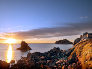 Rocky coast in Brittany. Sunset over the sea
