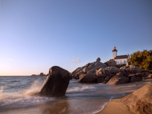 Phare de Pontusval lighthouse in Brittany. Evening sun, view from the beach