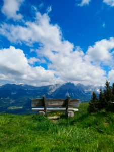 View of the Wilder Kaiser in Elmau with a rest bench in the foreground