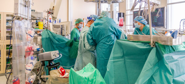 Surgeons-Heart valve replacement surgery, operating room,
