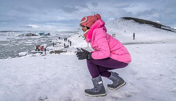 Winter -  Tourists at the Jokusarlon Glacial Lagoon, Iceland