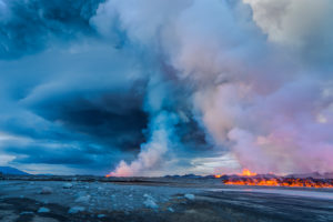 Volcano Eruption at the Holuhraun Fissure near Bardarbunga Volcano, Iceland.  A late afternoon view of part of the Holuhraun fissure erupting as lava and steam rise into the air near the Bardarbunga Volcano, Iceland. Bardarbunga is a subglacial stratovolcano located under the ice cap of Vatnajokull glacier. Picture date- Sept. 2, 2014