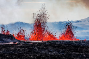 Aerial view of lava and plumes. August 29, 2014 a fissure eruption started in Holuhraun at the northern end of a magma intrusion, which had moved progressively north, from the Bardarbunga volcano. Bardarbunga is a stratovolcano located under Vatnajokull, Iceland's most extensive glacier. Picture Date: September 3, 2014 People standing by Flosagja fissure, Thingvellir National Park, Iceland