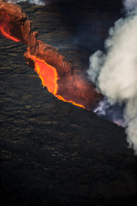 Aerial view of lava and plumes. August 29, 2014 a fissure eruption started in Holuhraun at the northern end of a magma intrusion, which had moved progressively north, from the Bardarbunga volcano. Bardarbunga is a stratovolcano located under Vatnajokull, Iceland's most extensive glacier. Picture Date-Sept. 28, 2014