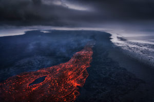 Aerial view of lava and plumes. August 29, 2014 a fissure eruption started in Holuhraun at the northern end of a magma intrusion, which had moved progressively north, from the Bardarbunga volcano. Bardarbunga is a stratovolcano located under Vatnajokull, Iceland's most extensive glacier. Picture Date-October 30, 2014