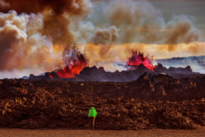 Person close to the new lava. August 29, 2014 a fissure eruption started in Holuhraun at the northern end of a magma intrusion, which had moved progressively north, from the Bardarbunga volcano. Bardarbunga is a stratovolcano located under Vatnajokull, Iceland's most extensive glacier. Picture Date-September 20, 2014