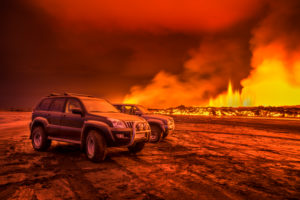 SUVs close to the Eruption at Holuhraun, near the Bardarbunga Volcano, Iceland. August 29, 2014 a fissure eruption started in Holuhraun at the northern end of a magma intrusion, which had moved progressively north, from the Bardarbunga volcano. Picture Date-Sept. 2, 2014