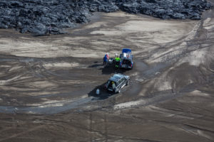 Aerial view of scientists and their jeeps by the lava flows. August 29, 2014 a fissure eruption started in Holuhraun at the northern end of a magma intrusion, which had moved progressively north, from the Bardarbunga volcano. Picture Date: September 3, 2014