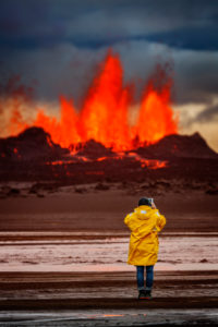 Woman taking pictures with a tablet at the volcano eruption at the Holuhraun fissure, by the Bardarbunga Volcano, Iceland. August 29, 2014 a fissure eruption started in Holuhraun at the northern end of a magma intrusion, which had moved progressively north, from the Bardarbunga volcano. . Picture Date-Sept. 1, 2014