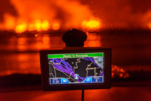 GPS with the Holuhraun Fissure Eruption in the background, Northern Iceland. August 29, 2014 a fissure eruption started in Holuhraun at the northern end of a magma intrusion, which had moved progressively north, from the Bardarbunga volcano. Picture Date-Sept. 2, 2014