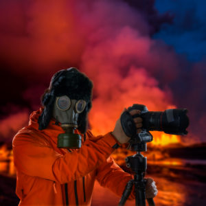 Photographer wearing a gas mask in front of glowing lava. Holuhraun, Bardarbunga Volcano eruption, Iceland