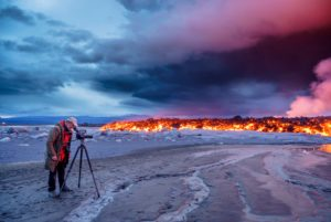 Photographer filming the volcano eruption at the Holuhraun Fissure, near the Bardarbunga Volcano, Iceland. August 29, 2014 a fissure eruption started in Holuhraun at the northern end of a magma intrusion, which had moved progressively north, from the Bardarbunga volcano, Picture Date-Sept. 2, 2014