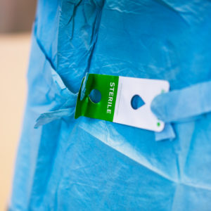 Tag on surgical gown- sterile, heart valve replacement surgery, operating room,