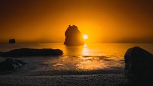 Sunset over rock formations, Reynisfjara beach, South Coast, Iceland