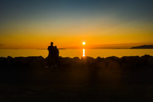 Couple enjoying the sunset, Saebraut street, Reykjavik, Iceland