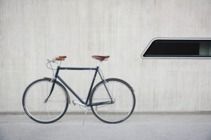Retro bicycle in front of wall