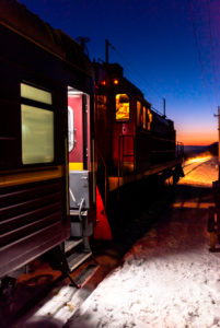 Trans-Siberian Railway at blue hour in winter, Lake Baikal, Siberia, Russia